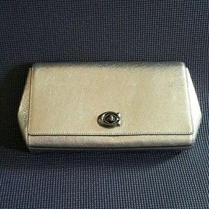 Coach silver clutch